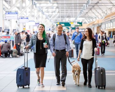 Steven Woo, employee of Vancouver Airport Authority, walking with friends and his assistance dog, Horatio.