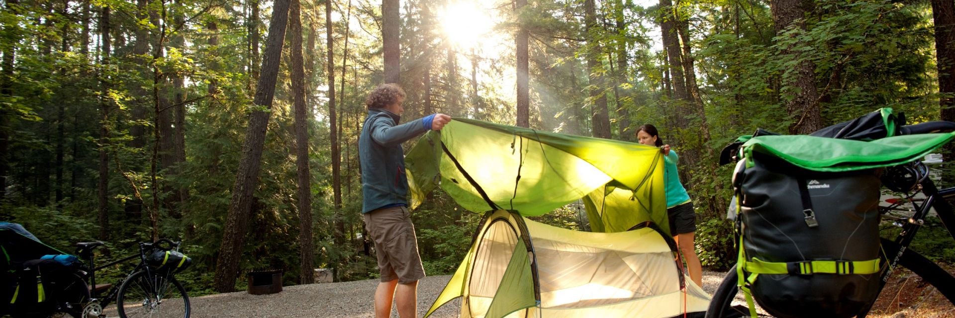 Couple setting up their tent at a campsite in Nairn Falls Provincial Park.
