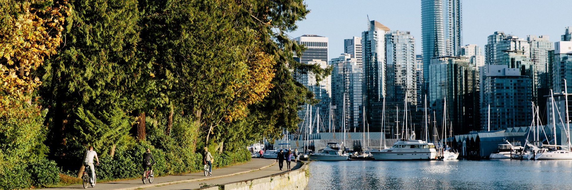 Cyclists and pedestrians riding around Stanley Park in Vancouver