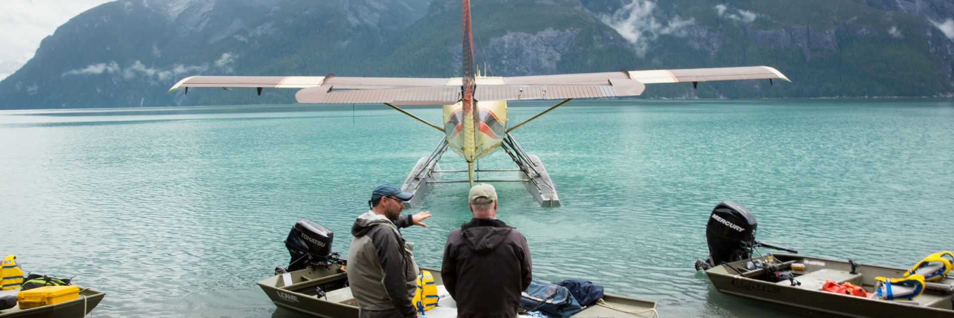 A group watching a float plane land in British Columbia.