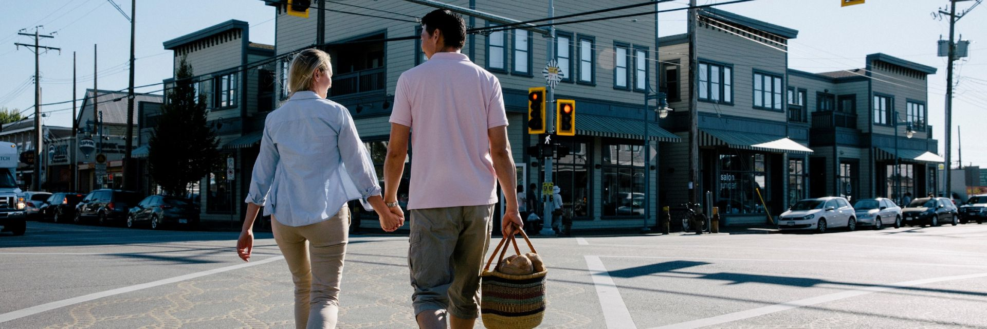 A couple walking through the intersection of Moncton & No 2 Road in Steveston Village