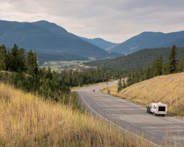 An RV traveling down a highway in British Columbia