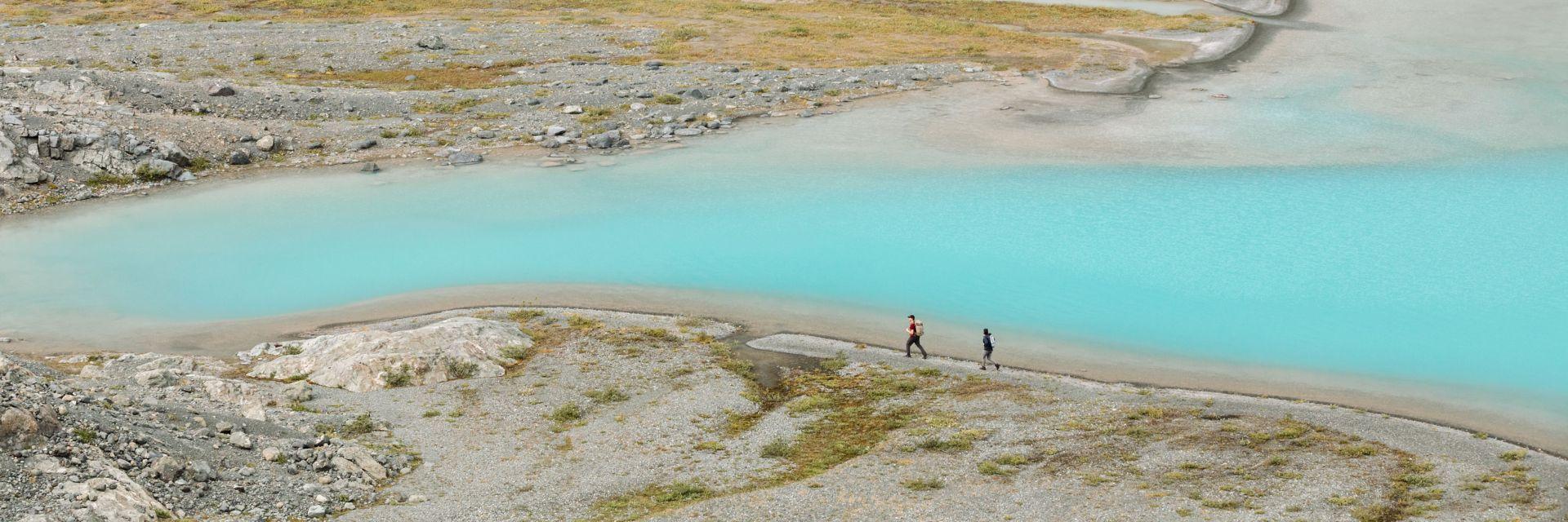 Hikers hiking through Tweedsmuir Glacier